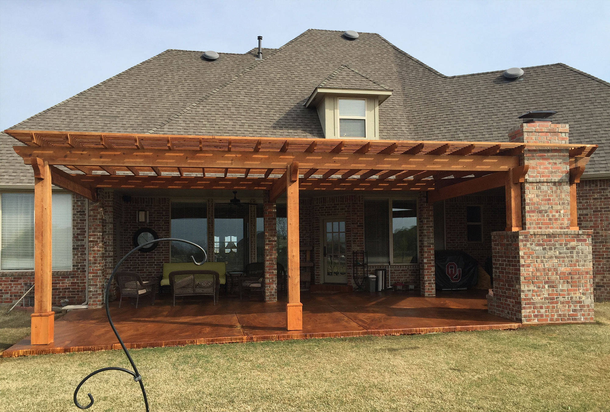 cedar pergola and concrete deck